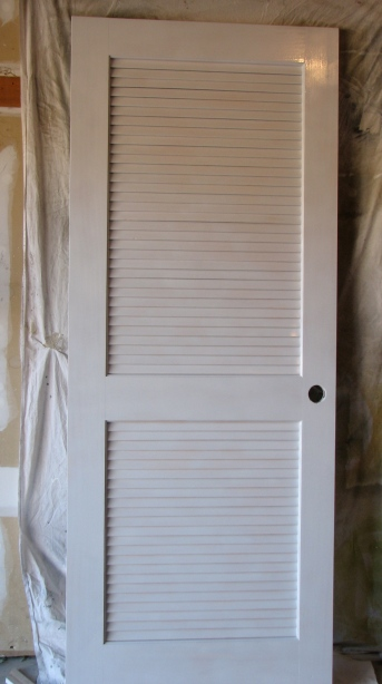 Spray painting louvered door -- House Over Head blog